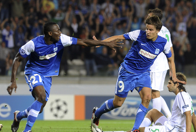GENK, BELGIUM - AUGUST 23:  Jelle Vossen of KRC Genk (R)   celebrates after scoring  his opening goal during the UEFA Champions League playoff match between KRC Genk and Maccabi Haifa FC at Cristal Arena on August 23, 2011 in Genk, Belgium.  (Photo by Din