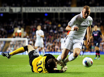 LONDON, ENGLAND - AUGUST 25:  Jamie Macdonald of Hearts (L) fouls Harry Kane of Tottenham Hotspur during the UEFA Europa League play-off match between Tottenham Hotspur FC and Heart of Midlothian FC at White Hart Lane on August 25, 2011 in London, England
