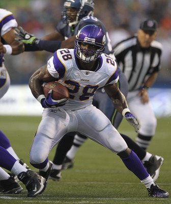 SEATTLE - AUGUST 20:  Running back Adrian Peterson #28 of the Minnesota Vikings rushes against the Seattle Seahawks at CenturyLink Field on August 20, 2011 in Seattle, Washington. (Photo by Otto Greule Jr/Getty Images)
