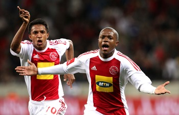 CAPE TOWN, SOUTH AFRICA - AUGUST 27: Thulani Serero from Ajax CT celebrates his goal during the Absa Premiership match between Ajax Cape Town and Blomfontein Celtic at Cape Town Stadium on August 27: 2010 in Cape Town, South Africa. (Photo by Carl Fourie/