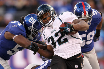 EAST RUTHERFORD, NJ - NOVEMBER 28: Maurice Jones-Drew of the Jacksonville Jaguars is tackled by Jonathan Goff #54 of the New York Giants at New Meadowlands Stadium on November 28, 2010 in East Rutherford, New Jersey.  (Photo by Chris McGrath/Getty Images)