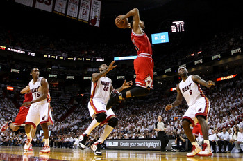 MIAMI, FL - MAY 24:  Derrick Rose #1 of the Chicago Bulls goes up for a dunk against Mario Chalmers #15, Udonis Haslem #40 and LeBron James #6 of the Miami Heat in the first half of Game Four of the Eastern Conference Finals during the 2011 NBA Playoffs o