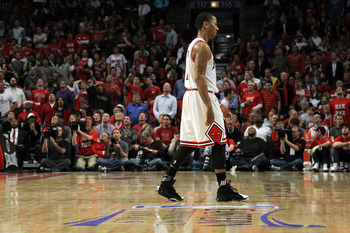 CHICAGO, IL - MAY 26:  Derrick Rose #1 of the Chicago Bulls walks towards the bench against the Miami Heat in Game Five of the Eastern Conference Finals during the 2011 NBA Playoffs on May 26, 2011 at the United Center in Chicago, Illinois. NOTE TO USER: