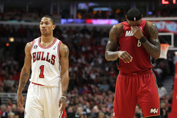 CHICAGO, IL - MAY 26: (L-R) Derrick Rose #1 of the Chicago Bulls looks on as LeBron James #6 of the Miami Heat wipes his face with his jersey in Game Five of the Eastern Conference Finals during the 2011 NBA Playoffs on May 26, 2011 at the United Center i