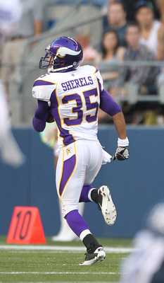SEATTLE - AUGUST 20:  Cornerback Marcus Sherels #35 of the Minnesota Vikings returns an interception for a touchdown as Golden Tate #81, and Max Unger #60 of the Seattle Seahawks look on at CenturyLink Field on August 20, 2011 in Seattle, Washington. Sher