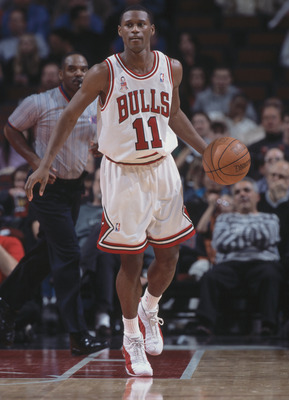 4 Dec 2001:  Guard A.J. Guyton #11 of the Chicago Bulls dribbles the ball during the NBA game against the Houston Rockets at the United Center in Chicago, Illinois.  The Bulls crushed the Rockets 103-75.Mandatory Credit:  Jonathan Daniel/Getty Images