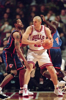 2 Dec 2000:   Dragan Tarlac #12 of the Chicago Bulls is double teamed by Macus Camby #23 of the New York Knicks at the United Center in Chicago, Illinois. The knicks defeated the Bulls 91-86.   NOTE TO USER: It is expressly understood that the only rights