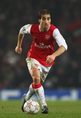 LONDON - FEBRUARY 20:  Mathieu Flamini of Arsenal in action during the UEFA Champions League first knockout round, first leg match between Arsenal and AC Milan at the Emirates Stadium on February 20, 2008 in London, England.  (Photo by Clive Mason/Getty I
