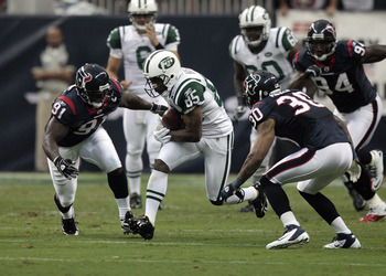 HOUSTON - AUGUST 15:  Wide receiver Derrick Mason #85 of the New York Jets looks for room to run as inside linebacker Tim Dobbins #91 and cornerback Jason Allen #30 of the Houston Texans position for the tackle at Reliant Stadium on August 15, 2011 in Hou