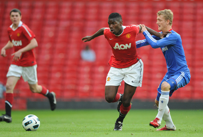 MANCHESTER, ENGLAND - APRIL 20:  Bobby Devyne of Chelsea battles Paul Pogba of Manchester United during the FA Youth Cup Semi Final 2nd Leg between Manchester United and Chelsea at Old Trafford on April 20, 2011 in Manchester, England.  (Photo by Michael