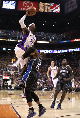 PHOENIX, AZ - MARCH 13:  Hakim Warrick #21 of the Phoenix Suns puts up a shot over Jameer Nelson #14 of the Orlando Magic during the NBA game at US Airways Center on March 13, 2011 in Phoenix, Arizona. The Magic defeated the Suns 111-88.  NOTE TO USER: Us