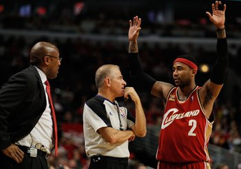 CHICAGO - APRIL 25: Head coach Mike Brown (L) and Mo Williams #2 of the Cleveland Cavaliers talk with referee Bennett Salvatore #15 as a member of the Chicago Bulls shoots a free-throw in Game Four of the Eastern Conference Quarterfinals during the 2010 N