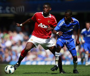 LONDON, ENGLAND - APRIL 10:  Adam Nditi (R) of Chelsea in action against Paul Pogba of Manchester United during the FA Youth Cup sponsored by E.on semi final first leg match between Chelsea and Manchester United at Stamford Bridge on April 10, 2011 in Lon