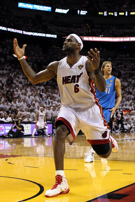 MIAMI, FL - JUNE 12:  LeBron James #6 of the Miami Heat reacts in front of Dirk Nowitzki #41 of the Dallas Mavericks in Game Six of the 2011 NBA Finals at American Airlines Arena on June 12, 2011 in Miami, Florida. NOTE TO USER: User expressly acknowledge