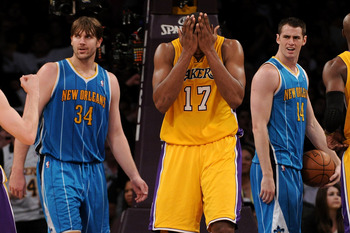 LOS ANGELES, CA - APRIL 26:  Andrew Bynum #17 of the Los Angeles Lakers reacts in the third quarter after making a basket and getting fouled as he stands between Aaron Gray #34 and Jason Smith #14 of the New Orleans Hornets in Game Five of the Western Con