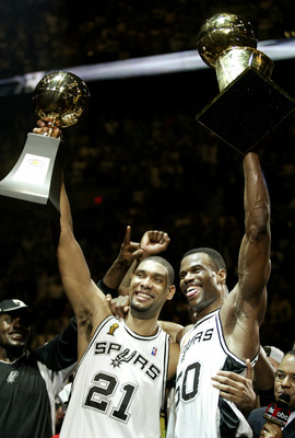 SAN ANTONIO, TX - JUNE 15:  Tim Duncan #21 and David Robinson #50 of the San Antonio Spurs celebrate after winning Game six of the 2003 NBA Finals against the New Jersey Nets on June 15, 2003 at the SBC Center in San Antonio, Texas.  The Spurs won 88-77 a