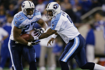 INDIANAPOLIS - NOVEMBER 3:  Quarterback Steve McNair #9 of the Tennessee Titans hands off the ball to teammate Eddie George #27 in the second half against the Indianapolis Colts on November 3, 2002 at the RCA Dome in Indianapolis, Indiana.  The Titans bea