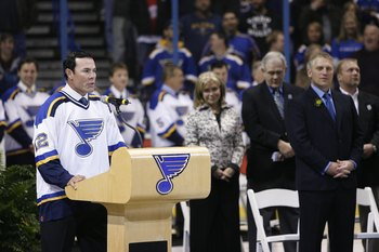 ST. LOUIS - DECEMBER 5:  Former player Adam Oates speaks during the Brett Hull jersey retirement ceremony before the St. Louis Blues game against the Detroit Red Wings at Scottrade Center on December 5, 2006 in St. Louis, Missouri. The Red Wings won 5-1.