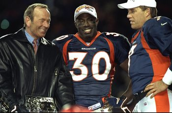 17 Jan 1999:  Terrell Davis #30 of the Denver Broncos stands with Broncos owner Pat Bowlen (L) and John Elway #7 after winning the AFC Championship Game against the New York Jets at Mile High Stadium in Denver, Colorado. The Broncos defeated the Jets 23-1