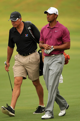 PONTE VEDRA BEACH, FL - MAY 11:  Tiger Woods (R) and caddie Steve Williams (L) walk together during a practice round prior to the start of THE PLAYERS Championship held at THE PLAYERS Stadium course at TPC Sawgrass on May 11, 2011 in Ponte Vedra Beach, Fl