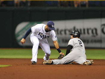 ST. PETERSBURG, FL - JULY 20:  Infielder Derek Jeter #2 of the New York Yankees steals second base against the Tampa Bay Rays July 20, 2011 at Tropicana Field in St. Petersburg, Florida.  (Photo by Al Messerschmidt/Getty Images)