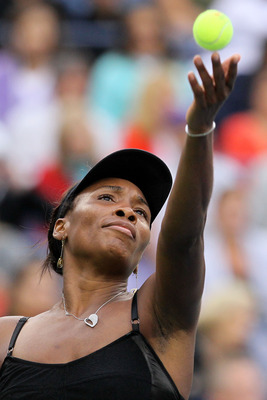 NEW YORK - SEPTEMBER 10:  Venus Williams of the United States serves against Kim Clijsters of Belgium during her women's semifinal match on day twelve of the 2010 U.S. Open at the USTA Billie Jean King National Tennis Center on September 10, 2010 in the F
