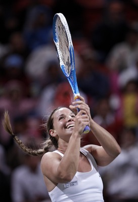 DOHA, QATAR - FEBRUARY 21:  Dominika Cibulkova of Slovakia celebrates her win over Venus Williams of the US on day four of the WTA Qatar Total Open match at the Khalifa International Tennis Complex on February 21, 2008 in Doha, Qatar. Cibulkova won her ma