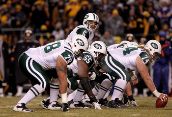 PITTSBURGH, PA - JANUARY 23:  Quarterback Mark Sanchez #6 of the New York Jets calls signals at the line of scgimmage behind Wayne Hunter #78, Brandon Moore #65 and center Nick Mangold #74 against the Pittsburgh Steelers during the 2011 AFC Championship g