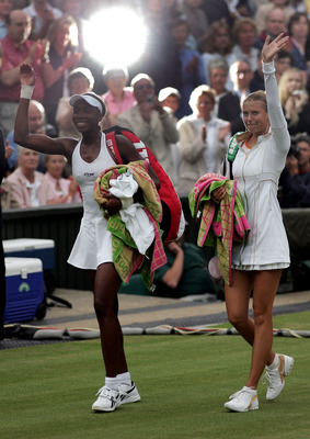 LONDON - JUNE 30:  Venus Williams of USA and Maria Sharapova of Russia walk off after Williams won in straight sets during the tenth day of the Wimbledon Lawn Tennis Championship on June 30, 2005 at the All England Lawn Tennis and Croquet Club in London.