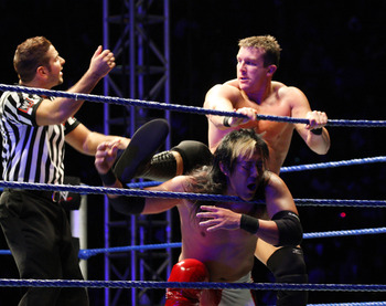 DURBAN, SOUTH AFRICA - JULY 08:  Ted DiBiase battles Yoshi Tatsu during the WWE Smackdown Live Tour at Westridge Park Tennis Stadium on July 08, 2011 in Durban, South Africa.  (Photo by Steve Haag/Gallo Images/Getty Images)