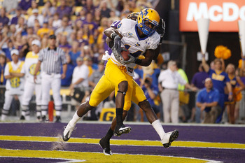 BATON ROUGE, LA - OCTOBER 16:  Damion Dixon #14 of the McNeese State Cowboys catches a touchdown pass over Morris Claiborne #17 of the Louisiana State University Tigers at Tiger Stadium on October 16, 2010 in Baton Rouge, Louisiana.  (Photo by Chris Grayt