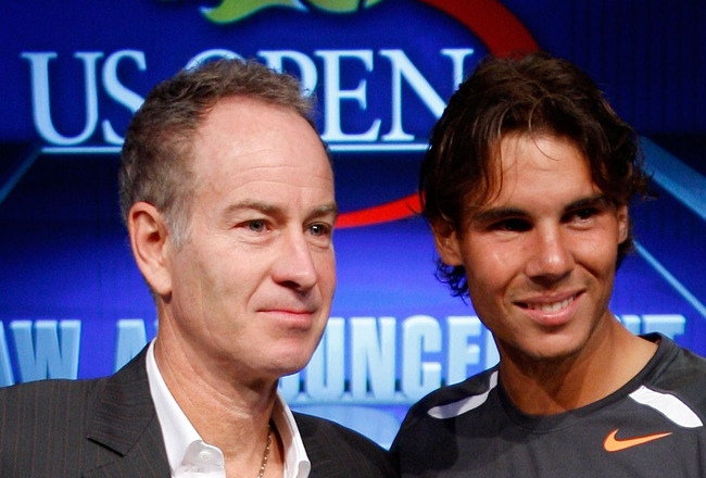 NEW YORK, NY - AUGUST 25:  John McEnroe and Rafael Nadal of Spain smile alongside the Men's U.S. Open trophy after participating in the Draw Ceremony prior to the start of the 2011 U.S. Open at the USTA Billie Jean King National Tennis Center on August 25