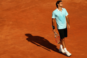 ROME - MAY 09: Roger Federer of Switzerland shows his dejection as he loses in straight sets against Radek Stepanek of the Czech Republic during their quarter-final match at the ATP Masters Series at the Foro Italico, on May 9, 2008 in Rome, Italy.  (Phot