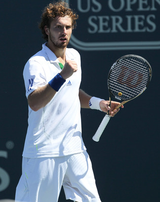 LOS ANGELES, CA - JULY 31:  Ernests Gulbis of Latvia celebrates a point against Mardy Fish in the singles final of the Farmers Classic presented by Mercedes-Benz at the LA Tennis Center on July 31, 2011 in Los Angeles, California.   Gulbis won 5-7, 6-4, 6