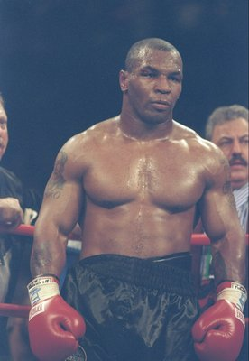 28 Jun 1997:  Mike Tyson looks on during a bout against Evander Holyfield at the MGM Grand Garden in Las Vegas, Nevada.  Tyson was disqualified in the third round by referee Mills Lane after biting Holyfield twice. Mandatory Credit: Jed Jacobsohn/Allsport