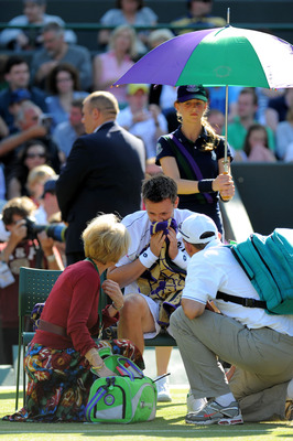 LONDON, ENGLAND - JUNE 25:  Robin Soderling of Sweden receives medical attention  during his third round match against Bernard Tomic of Australia on Day Six of the Wimbledon Lawn Tennis Championships at the All England Lawn Tennis and Croquet Club on June
