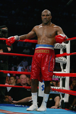 ATLANTIC CITY-JUNE 1:   Evander Holyfield waits in his corner  during the heavyweight title fight against Hasim Rahman at the Boardwalk Hall in Atlantic City, New Jersey on June 1, 2002. The fight was stopped after the 8th round in Holyfield's favor, afte