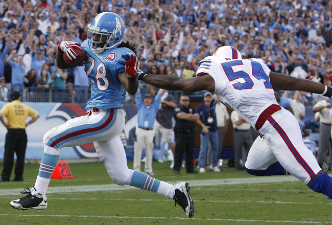 NASHVILLE, TN - NOVEMBER 15: Chris Johnson #28 of the Tennessee Titans breaks free from Nic Harris #54 of the Buffalo Bills as he runs in for the touchdown in their NFL game at LP Field on November 15, 2009 in Nashville, Tennessee.    (Photo by John Somme