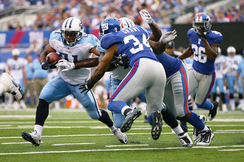 EAST RUTHERFORD, NJ - SEPTEMBER 26: Javon Ringer #21 of the Tennessee Titans runs the ball against the New York Giants at New Meadowlands Stadium on September 26, 2010 in East Rutherford, New Jersey.  The Titans defeated the Giants 29 - 10. (Photo by Andr
