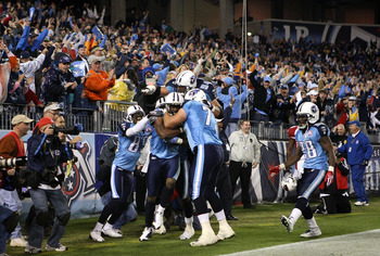 NASHVILLE, TN - NOVEMBER 29:  Kenny Britt #18 of the Tennessee Titans celebrates with teammate Jevon Kearse #90 after catching the game-winning touchdown to give the Titans a 20-17 victory over the Arizona Cardinals during their game at LP Field on Novemb