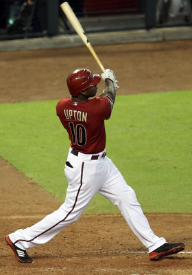 PHOENIX, AZ - AUGUST 14:  Justin Upton #10 of the Arizona Diamondbacks hits a solo home run against the New York Mets  during the fifth inning of the Major League Baseball game at Chase Field on August 14, 2011 in Phoenix, Arizona.  (Photo by Christian Pe