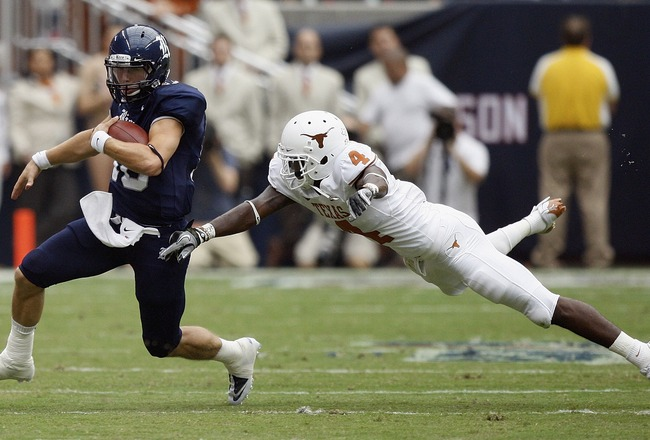 HOUSTON - SEPTEMBER 04:  Quarterback Taylor McHargue #16 of the Rice Owls avoids a diving cornerback Aaron Williams #4 of the Texas Longhorns at Reliant Stadium on September 4, 2010 in Houston, Texas.  (Photo by Bob Levey/Getty Images)