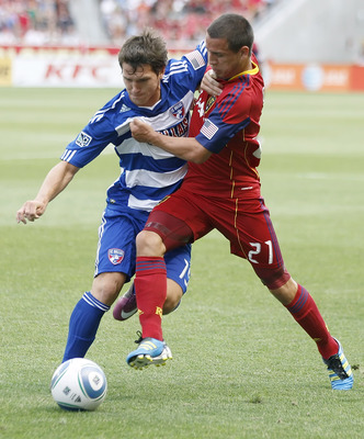 SANDY, UT - JULY 9: Luis Gil #21 of Real Salt Lake and Zach Loyd #19 of FC Dallas fights for the ball during the first half of an MLS soccer game July 9, 2011 at Rio Tinto Stadium in Sandy, Utah. (Photo by George Frey/Getty Images)