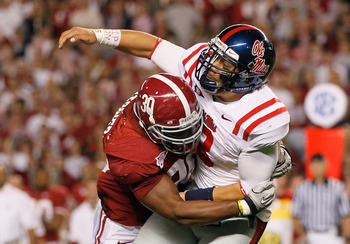 TUSCALOOSA, AL - OCTOBER 16:  Dont'a Hightower #30 of the Alabama Crimson Tide pressures quarterback Jeremiah Masoli #8 of the Ole Miss Rebels at Bryant-Denny Stadium on October 16, 2010 in Tuscaloosa, Alabama.  (Photo by Kevin C. Cox/Getty Images)