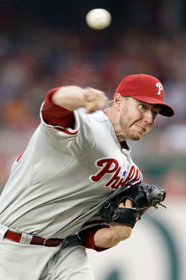 WASHINGTON, DC - AUGUST 21:  Starting pitcher Roy Halladay #34 of the Philadelphia Phillies throws to a Washington Nationals batter during the fourth inning at Nationals Park on August 21, 2011 in Washington, DC.  (Photo by Rob Carr/Getty Images)