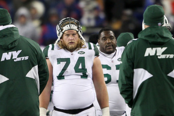 FOXBORO, MA - DECEMBER 06:  Nick Mangold #74 of the New York Jets looks on against the New England Patriots at Gillette Stadium on December 6, 2010 in Foxboro, Massachusetts. The Patriots won 45-3. (Photo by Elsa/Getty Images)
