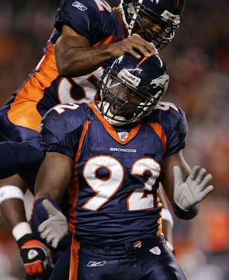 DENVER - OCTOBER 15:  Defensive End Elvis Dumervil #92 of the Denver Broncos celebrates a sack on quarterback Andrew Walter of the Oakland Raiders with linebacker Ian Gold #52 in the first quarter on October 15, 2006 at Invesco Field at Mile High in Denve