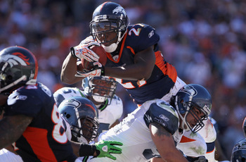 DENVER - SEPTEMBER 19:  Running back Knowshon Moreno #27 of the Denver Broncos goes over linbacker Lofa Tatupu #51 of the Seattle Seahawks for a one yard touchdown in the third quarter at INVESCO Field at Mile High on September 19, 2010 in Denver, Colorad