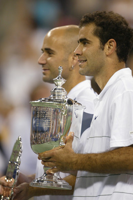 FLUSHING, NY - SEPTEMBER 8:  (FILE PHOTO)  Pete Sampras poses with his trophy and Andre Agassi during the US Open September 8, 2002 at the USTA National Tennis Center in Flushing Meadows Corona Park in Flushing, New York.  Sampras is retiring in a brief c