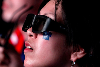SAITAMA, JAPAN - JUNE 19:  Fans, wearing 3D glasses, watch 3D images projected on a large screen ahead of the 2010 FIFA World Cup South Africa Group E match between the Netherlands and Japan during a public viewing event at Saitama Super Arena on June 19,